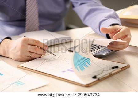 Financial Inspector Report Calculating Balance. Internal Revenue Service Worker Checking Document. A
