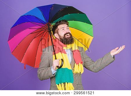An Umbrella Is Needed On A Rainy Day. Autistic Or Rain Man Holding Colorful Umbrella. Autism. Bearde