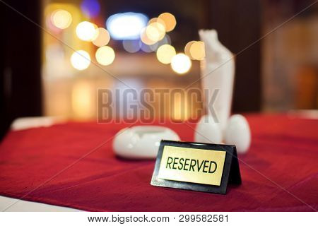 Reserved Table. A Sign Of Reservation Placed In Restaurant