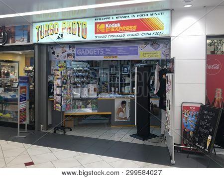 Verona, Italy - April 27, 2019: Entrance Of Kodak Express Photoshop Turbo Photo At A Shopping Center