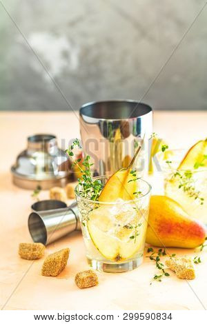 Pear Mulled Cider With Thyme, Brown Sugar And Ice  On Light Concrete Surface Table
