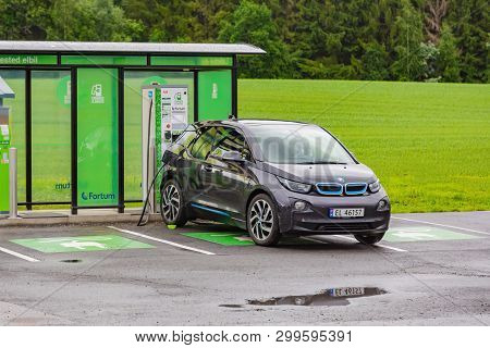 Bergen, Norway - Jule, 2016: Ev Car Or Electric Car At Charging Station With The Power Cable Supply