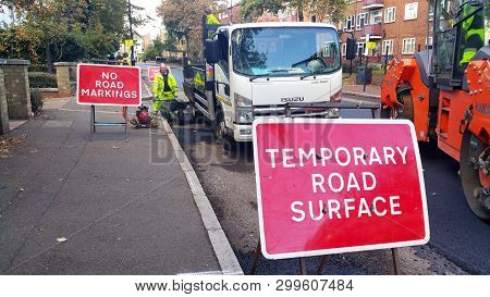 London, Uk - October 29, 2018: Workers Put Some Signs And Closed The Road Because Of A Roadwork In A