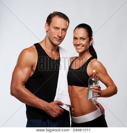 Athletic man and woman after fitness exercise poster