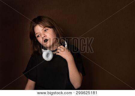 Portrait Of A Sad Teen Girl In Dark Colors