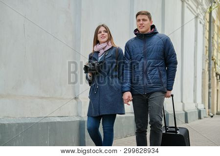 Tourists Young Couple Walking Around The City With Camera Suitcase, Youth Traveling, Winter Spring S