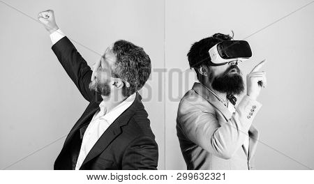 Business implement modern technology. Real fun and virtual alternative. Man with beard in VR glasses and louvered plastic accessory. Guy interact in virtual reality. Hipster exploring virtual reality poster