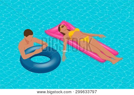 Inflatable Ring And Mattress. Young Man Nad Woman On Air Mattress In The Big Swimming Pool. Summer H