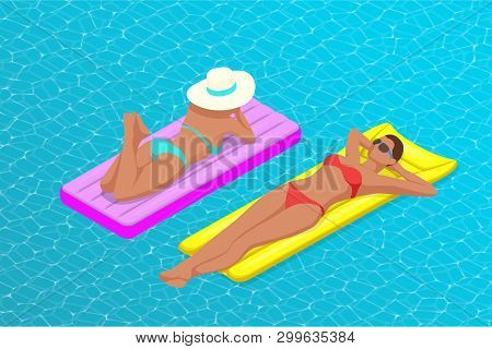 Inflatable Ring And Mattress. Young Women On Air Mattress In The Big Swimming Pool. Summer Holiday I