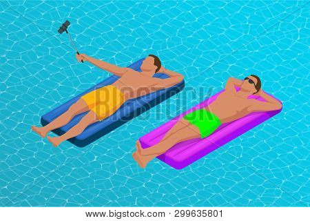 Inflatable Ring And Mattress. Young Men On Air Mattress In The Big Swimming Pool. Summer Holiday Idy