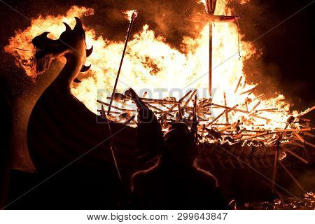 Up Helly Aa Burning Galley Ship And Viking Silhouetted Against The Inferno. Up Helly Aa Is A Viking