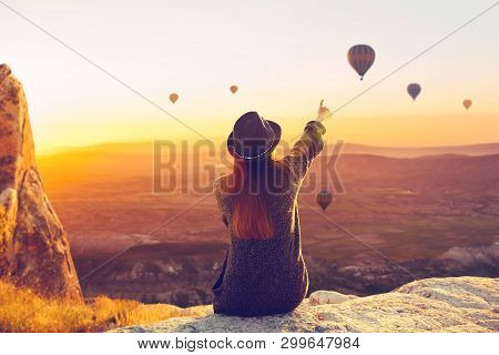 A Woman Alone Unplugged Sits On Top Of A Mountain And Admires The Flight Of Hot Air Balloons In Capp