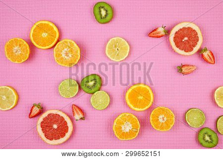 Summer Theme Background With Fruit, Citrus And Flowers On Pink Backdrop.