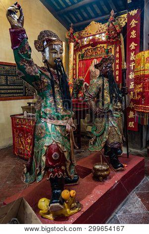 Hong Kong, China - March 7, 2019: Tai O Fishing Village. Two Life-size Statues Of Fierce Guards At K