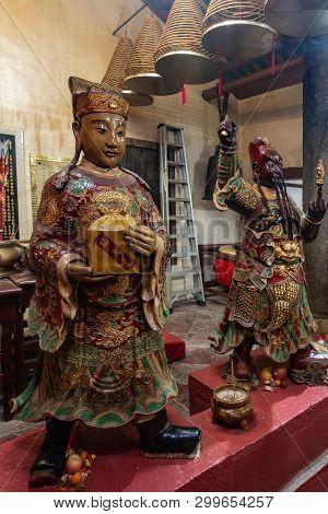 Hong Kong, China - March 7, 2019: Tai O Fishing Village. Two Life-size Statues Of Fierce Guards And