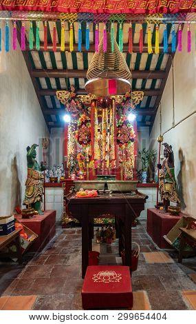Hong Kong, China - March 7, 2019: Tai O Fishing Village. God Of Sea Altar Partly Hidden By Garlands