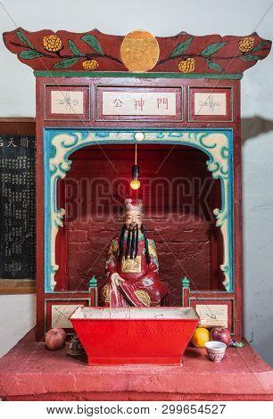 Hong Kong, China - March 7, 2019: Tai O Fishing Village. Closeup Of Side Shrine With Idol Captured I