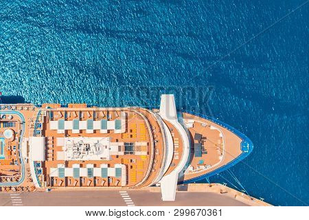Cruise Liner Luxury Ship In Berth Port, Blue Sea Water. Top Aerial View. Concept Travel Tour.