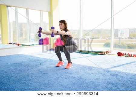 Woman Fitness. Beautiful Caucasian Senior Woman Doing Exercise In Gym . Healthy Lifestyle.
