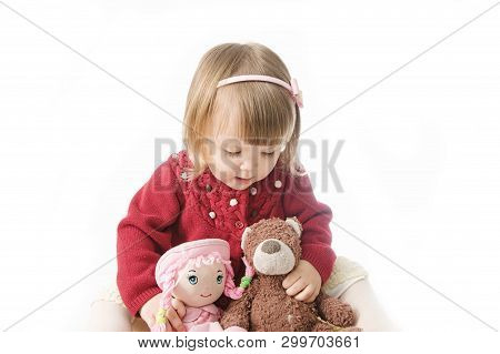 Playing Little Girl. Cute Caucasian Baby With Bear And Doll Isolated On White Background