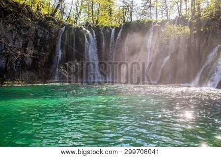 Beautiful Waterfalls  Falling In Green Lake Of Famous Plitvicka Lakes In Croatia.