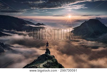 Person Standing On The Top Of Cliff