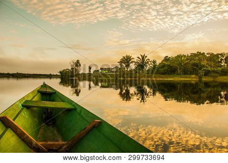 Beautiful Sunrise On The River. View From The Boat At Amazon River, With A Dense Forest On The Shore