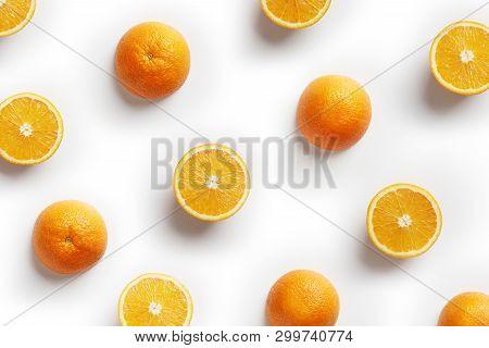 Fruit Pattern Of Fresh Orange Slices On White Background. Copy Space. Pop Art Design, Creative Summe