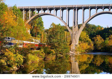 Arched Bridge And Passenger Train