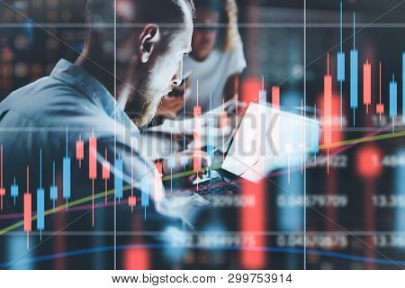 Businessman Working Together With Project Team At Night Office.technical Price Graph And Indicator,