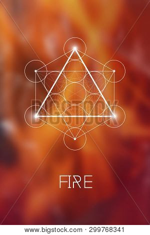 Sacred Geometry Fire Element Symbol Inside Metatron Cube And Flower Of Life In Front Of Natural Blur