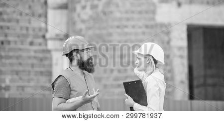 Safety Inspector Concept. Construction Site Safety Inspection. Discuss Progress Project. Woman Inspe