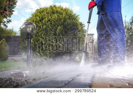 Driveway Pressure Wash. Cleaning Bricks Road And Garden Paths.