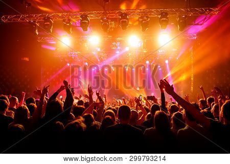Raised Hands In Honor Of A Musical Show On Stage