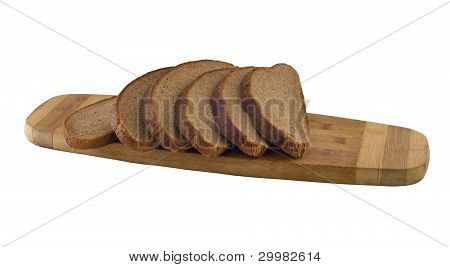 The Pieces Of Rye Brown Bread On The Chopping Board.