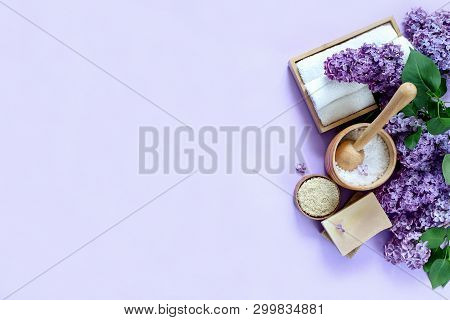 Spa And Massage Products With Lilac On Purple Background