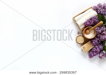Spa And Massage Products With Lilac On White Background