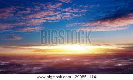 Beautiful Sunset .  Beautiful Heavenly Landscape With The Sun In The Clouds . View Of Clouds From Hi