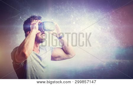 Man enjoying vr headset on fantasy background. Modern technology, virtual reality fun