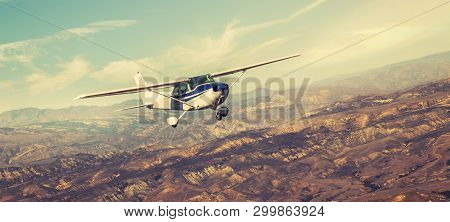 Small Single Engine Airplane Flying In The Gorgeous Sunset Sky Through The Sea Of Clouds Above The S