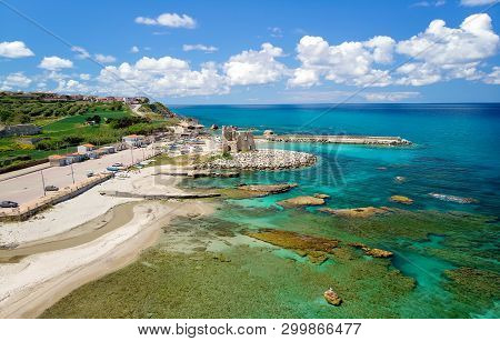 Fishing Italian Village Briatico In Calabria With Turquoise Sea And Old Saracen Tower. Drone Panoram