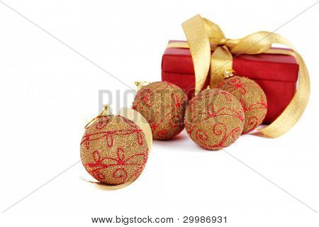 Christmas present with ball in golden tone