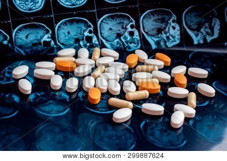Different Pharmaceutical Medicine Pills On Magnetic Brain Resonance Scan Mri Background. Pharmacy Th