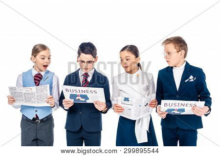 surprised schoolchildren pretending to be businesspeople reading newspapers Isolated On White poster