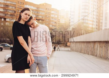 Unhappy Young Couple Of Friends, Teenagers, Students At City Street, Relationship Difficulties Conce
