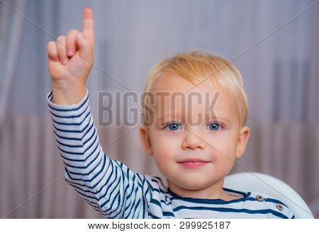I Have Excellent Idea. Boy Cute Toddler Blue Eyes Pointing Upwards Index Finger. Creative Idea Conce