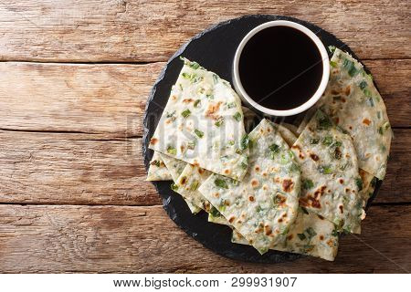 Vegan Scallion Pancakes Are A Crispy Pan-fried Chinese Flatbread Close-up On A Board. Horizontal Top