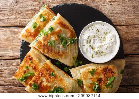 Afghan Fried Flat Breads With Potatoes, Green Onions And Cilantro Closeup. Horizontal Top View