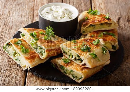 Rustic Style Afghan Fried Flatbread Bolani Stuffed With Potatoes, Green Onions And Cilantro Close-up