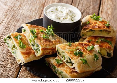 Traditional Afghan Friedflat Bread Bolani With Potatoes, Green Onions And Cilantro Closeup. Horizont